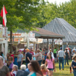 Crowds enjoy the weather at Mantua's Potato Festival on Saturday afternoon